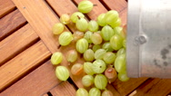 Gooseberries falling out of basket in slow motion Stock Footage