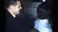 1961: a family is seen indoors and enjoying DETROIT, MICHIGAN Stock Footage
