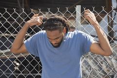 Man Holds to Fence in Ferguson Kuvituskuvat
