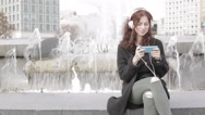 Girl listening music from smart phone mp3 player Stock Footage