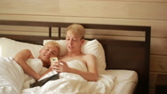 Happy gay couple using tablet in bed. gay couple. LGBT Stock Footage
