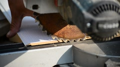 Man sawing MDF board with circular saw Stock Footage