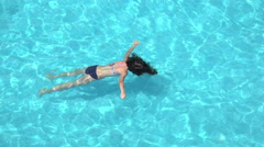 Drowning girl, woman in a swimming pool, 4k aerial shot Stock Footage