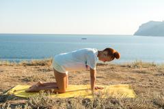 Yoga girl with wireless headphones Stock Photos