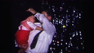1974: a father with child is seen near a christmas tree LYNBROOK, NEW YORK Stock Footage