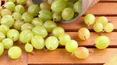 Gooseberries on wooden table Stock Footage