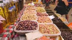 Olive products at the local market Stock Footage
