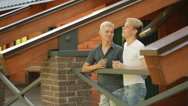 Gay men relaxing in the park. lgbt Stock Footage