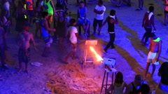 Men and women dance during Full Moon party on island Koh Phangan. Thailand Stock Footage