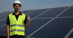 Worker Man Looking Camera Thumb Up Sign Hand Gesture Solar Panels Power Plant Stock Footage