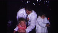 1974: father and funny three kids dressed in white with a toy gun LYNBROOK Stock Footage