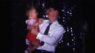 1974: baby teasing dad LYNBROOK, NEW YORK Stock Footage