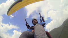 Tandem Paragliding in the Mountains Stock Footage