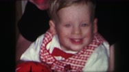 1974: christmas morning opening presents and looks of joy LYNBROOK, NEW YORK Stock Footage
