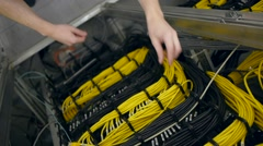 Hands plug out the yellow ethernet cable Stock Footage