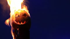 Scary pumpkin faces lit bright fire Stock Footage