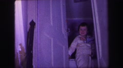 1974: door at the top of the stairs opens to two excited kids spilling down  Stock Footage