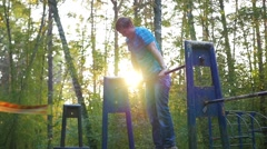 The guy practicing on the horizontal bar in the Park Stock Footage
