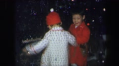 1974: children taking things from the floor of room with lot of mess LYNBROOK Stock Footage
