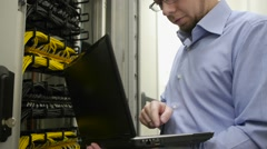 IT engineer checks the server rack Stock Footage