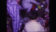 1974: children excitedly open presents at christmas LYNBROOK, NEW YORK Stock Footage