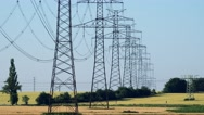 Power lines in countryside - blue sky - closeup Stock Footage