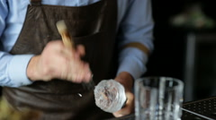 The bartender hands crushes ice for a cocktail Stock Footage