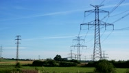 Power lines in countryside - blue sky Stock Footage