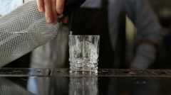 Bartender squirting on the ice of the siphon Stock Footage