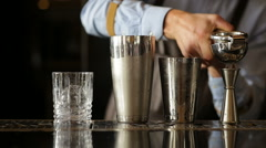 Bartender extrudes juice for a cocktail Stock Footage