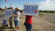 A group of campaigners holding Trump for president signs Stock Footage