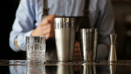 The bartender at the bar adds alcohol cocktail Stock Footage