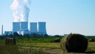 Field with plants (haystacks) - factory (nuclear power station) - smoke  Stock Footage