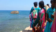 Tourists dressed in traditional south-eastern clothing enjoying ocean view Stock Footage