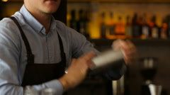 The bartender mixes the ingredients in a shaker Stock Footage