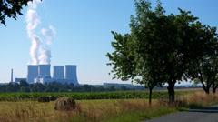 Factory (nuclear power station) - buildings and smoke from chimney - field  Stock Footage