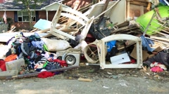 Flood Damaged Household Appliances and Goods Piled on the Ground Stock Footage