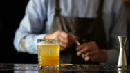Bartender nicely sprays a cocktail of alcohol Stock Footage