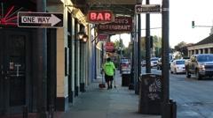Street Sweeper With Broom Walking Down Urban Louisiana Street Stock Footage
