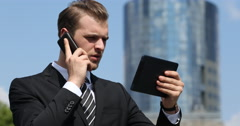 Business Man Talking Mobile Phone with Partner Positive Answer Office Building Stock Footage