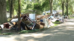 Pan Shot of Street Lined with Flood Damaged Household Goods Stock Footage