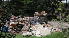 Bobcat Piles Flood Damaged Household Goods in Pile Stock Footage