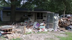 Tracking Shot of Flood Damaged Household Goods on Side of Street Stock Footage