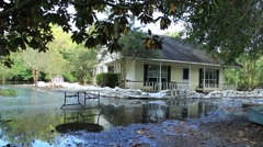 Sandbags surround house and protect it against flood water Stock Footage