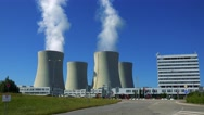 factory (nuclear power station) - closeup of buildings and smoke from chimney  Stock Footage