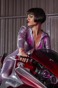 Rider, brunette woman mounted on a modern motorcycle customized and original, Stock Photos