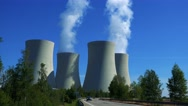 Factory (nuclear power station) - smoke from chimney - road with trees Stock Footage