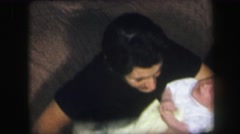 1974: well-dressed woman comforting a crying baby LYNBROOK, NEW YORK Stock Footage
