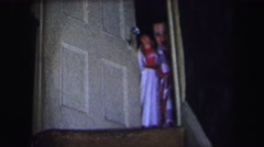 1974: two little ones who just can't stop waving goodbye for the camera Arkistovideo