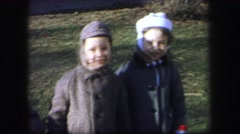 1974: three children in warm coats outside in winter gusty wind LYNBROOK Stock Footage